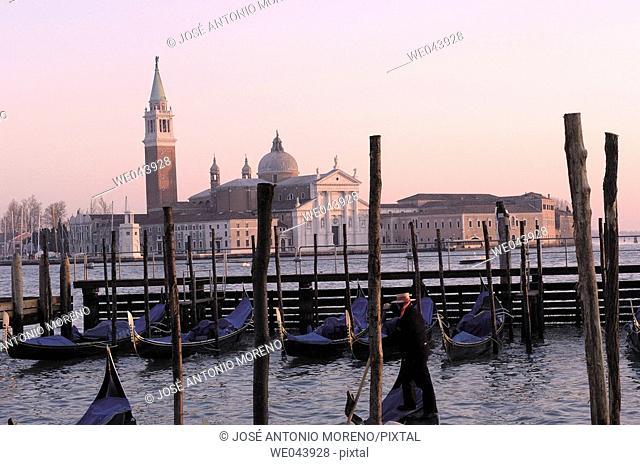 Gondolas at Piazzette San Marco pier and San Giorgio Maggiore in background, Venice. Veneto, Italy