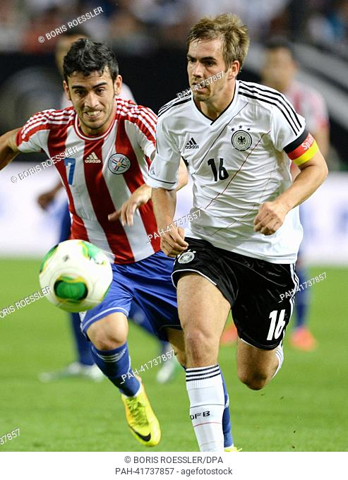 Germany's Philipp Lahm and Paraguay's Jose Ariel Nunez (l) vie for the ball during the international friendly soccer match between Germany vs Paraguay at...