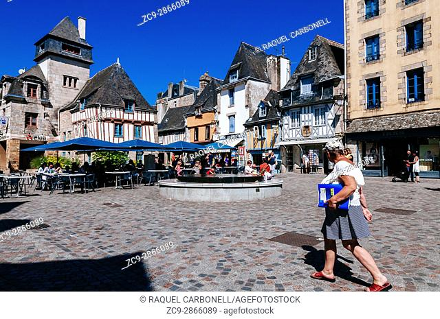 Tourists walking on stone ground narrow streets full of fifteenth-century row houses. Quimper, Brittany, France