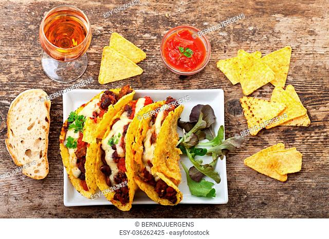 taco with chili con carne in a bowl