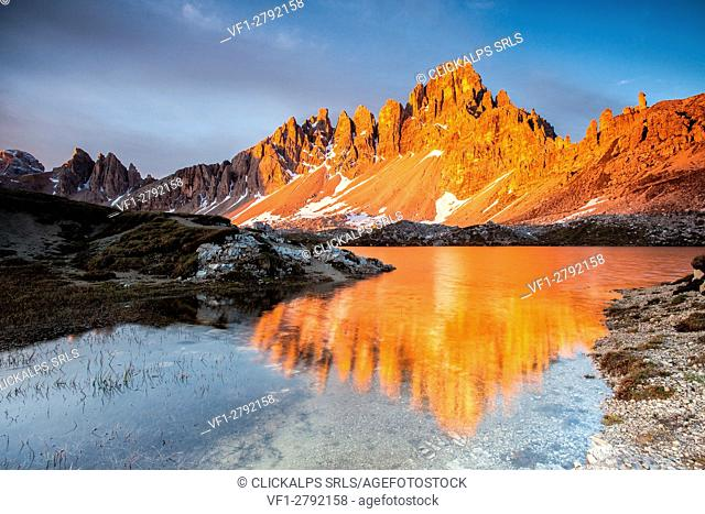 Dawn on the calcareous peaks of Mount Paterno reflected in the still water of Lakes of Piani. Locatelli refuge, Sesto of pusteria, Trentino Alto-Adige, Italy