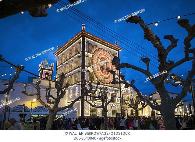 Portugal, Azores, Sao Miguel Island, Ponta Delgada, Festa Santo Christo dos Milagres festival, Igreja Nossa Senhora da Esperanca church lit for the festival