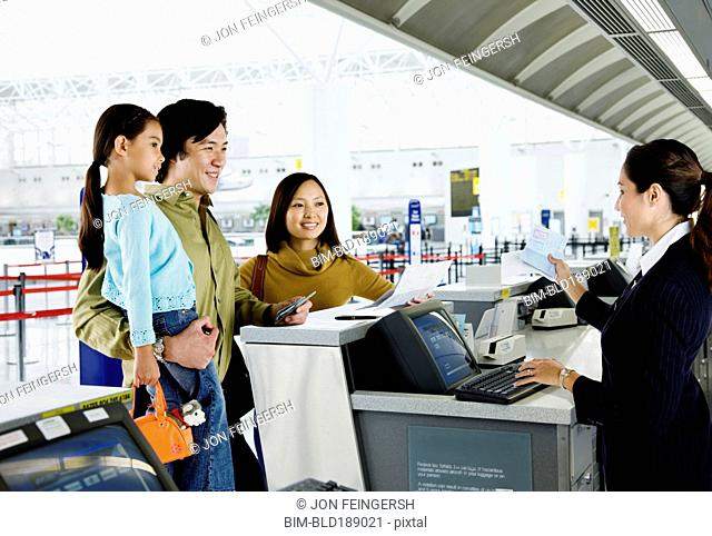 Asian family checking in at airport