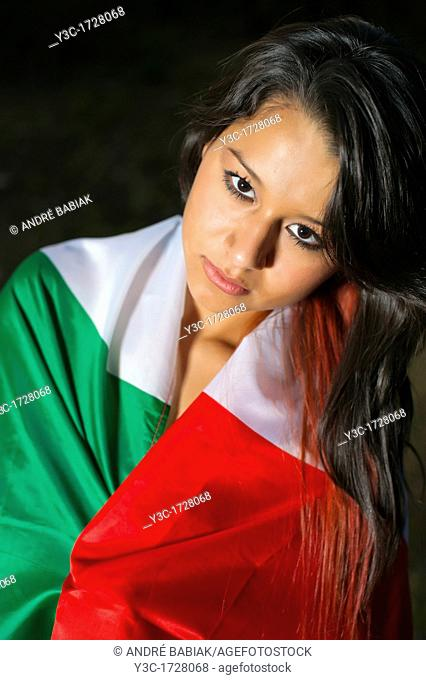 Young hispanic woman with Mexico flag