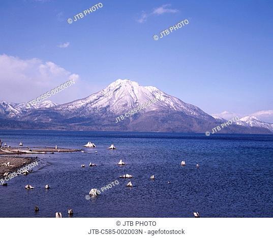 Snow-covered mountain Blue Early spring Lake Shikotsu Chitose Hokkaido Japan