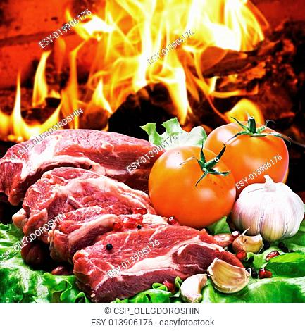pieces of steak and vegetables for grilling