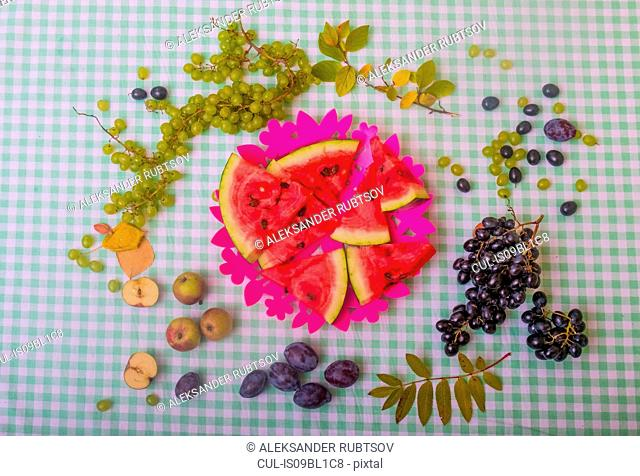 Black and white grapes, plums, apples and watermelon slices