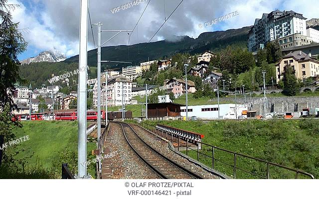 Alpine train running into St.Moritz station in the Swiss Alps, Switzerland