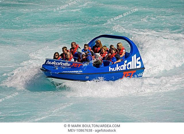 Tourists in Huka Falls jet boat Waikato River. Taupo North Island New Zealand