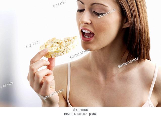 Caucasian woman eating rice cake
