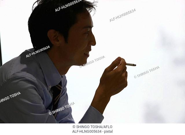 Japanese businessman in smoking room