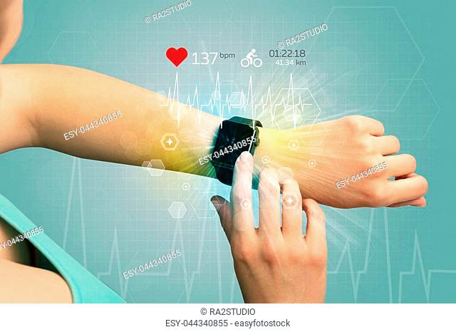 Hand with smartwatch and cycling concept nearby