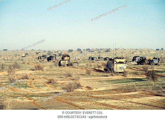 The 1st Armored Division 7th Corps advances on Iraqi forces during Operation Desert Storm. Feb. 25 1991. BSLOC-2011-12-3
