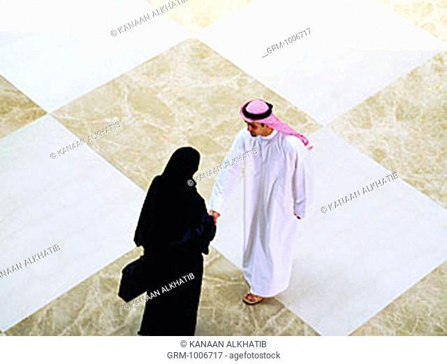 Handshake between Arab businesspeople
