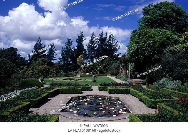 Bangor. National Trust property. Formal gardens. Hedging,paths. Pond. Water lilies