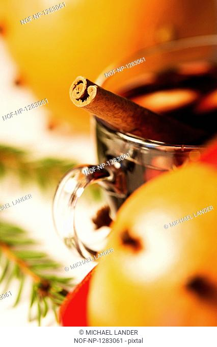 Mulled wine with a cinnamon stick and an orange with cloves in it, Christmas