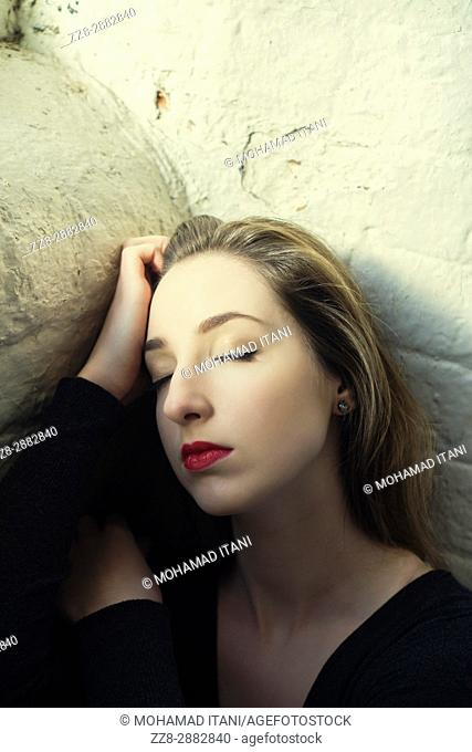 Portrait of a sad young woman eyes closed
