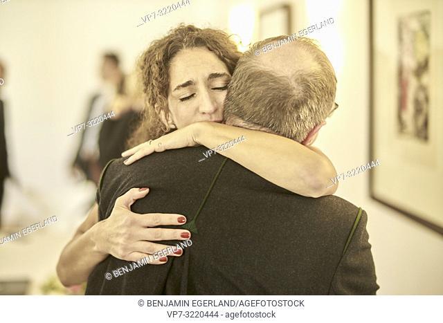 Bride embraces father in upper class wedding. Pöcking, Starnberg, Bavaria, Germany