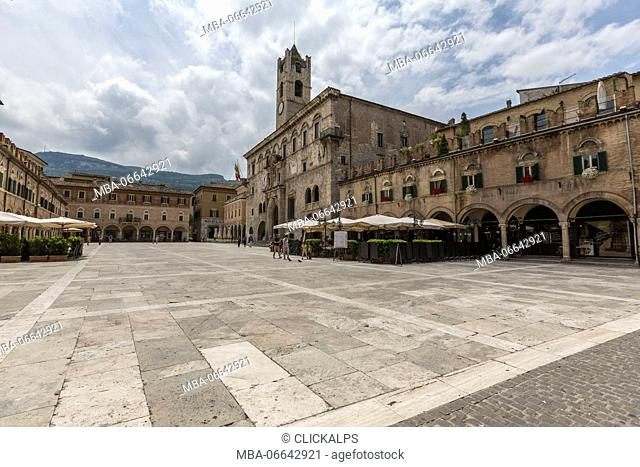 The old arcades frame the historical buildings of Piazza del Popolo Ascoli Piceno Marche Italy Europe