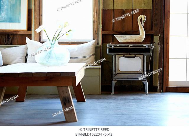 Antique stove, coffee table and bench in rustic living room