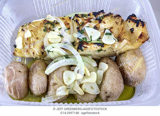 Portugal, Lisbon, Oriente, typical Portuguese food, grilled black cod, fish, garlic potatoes, plastic container, take-out