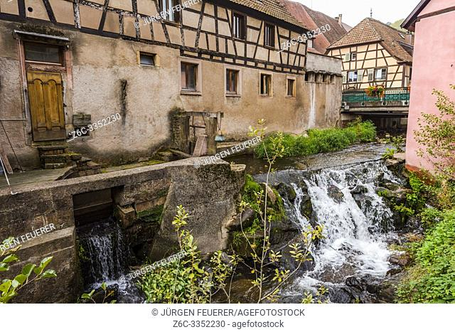 brook in the village Andlau, Alsace Wine Route, France, old mill and waterfall