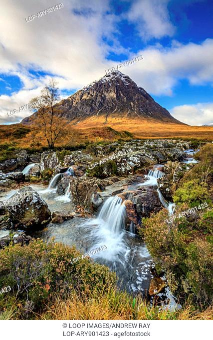 A waterfall on the River Coupall with Buachaillie Etive Mor in the distance