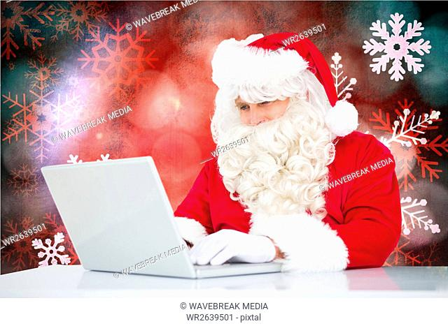 Santa claus using laptop