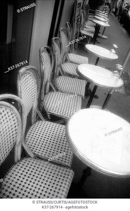Bistro chairs on sidewalk. Paris. France