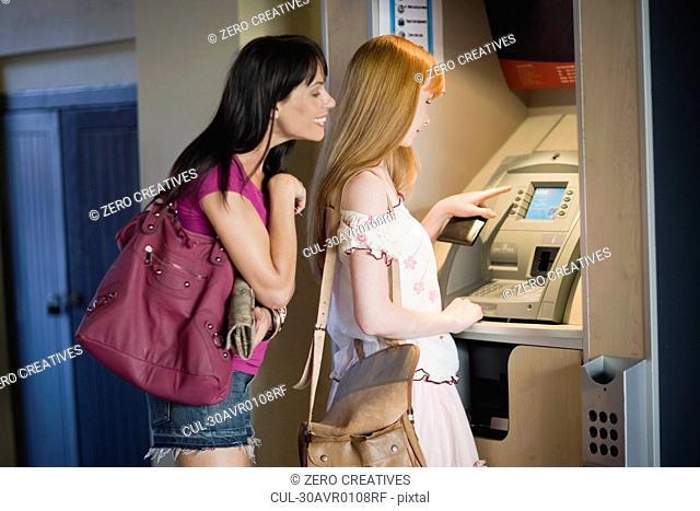 Women at a cashpoint