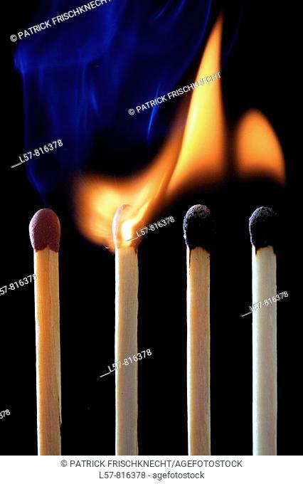 Close up of matches lighting, catching on fire, line of fire, smoking, Studio, Switzerland