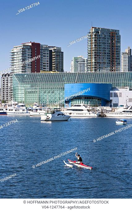 A man in his canoe on False Creek, Vancouver, British Columbia, Canada