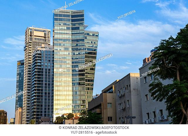 Office towers and residential skyscrapers in Lev HaIr district seen from Rothschild Boulevard in Tel Aviv city, Israel