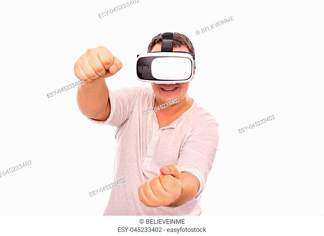 Man in virtual reality glasses is driving an invisible car playing a game or a simulator