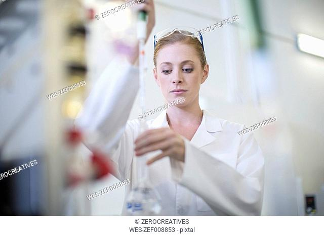 Young woman working in lab
