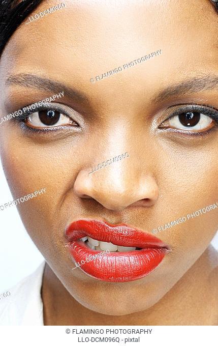 Studio shot of woman snarling, close-up