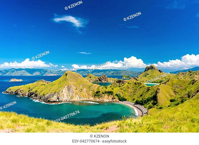 High-angle view of an idyllic seascape from Indonesia with the coastline of Padar Island in a sunny day of summer