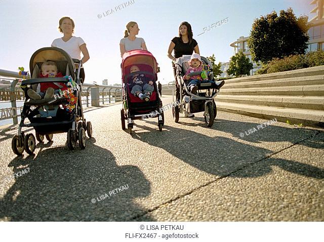 Women Walking Babies in Strollers
