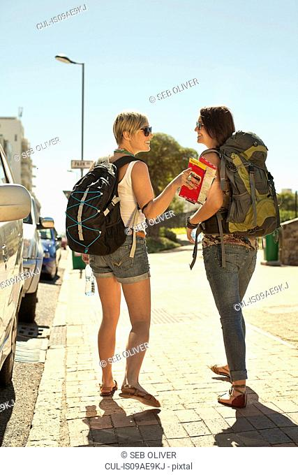 Two female backpackers with map, Cape Town, South Africa