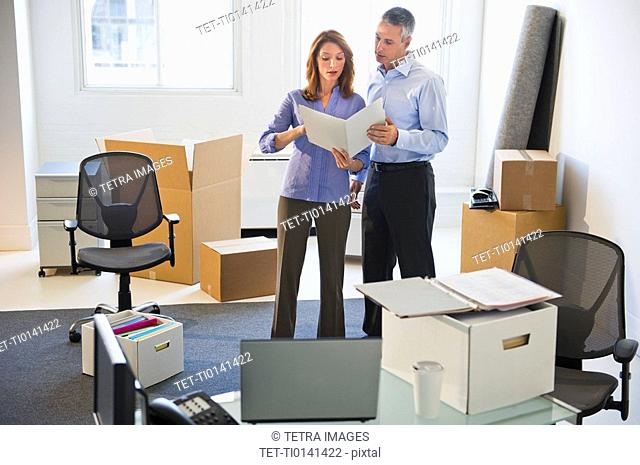 Business entrepreneurs working in startup office