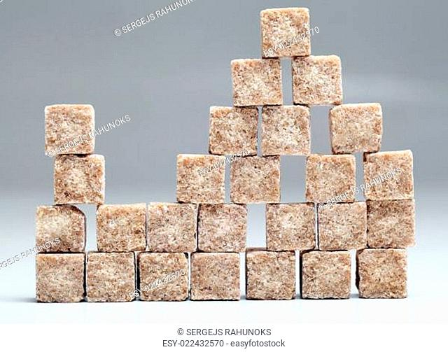 Wall of brown sugar cubes stacked up