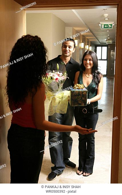 Young couple visit their friend
