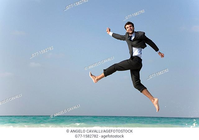 Maldives Islands Ari Atoll Business man jumping on the beach