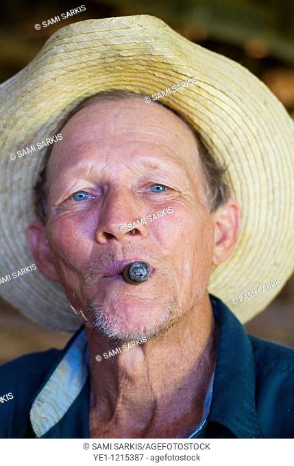 Portrait of a mature tobacco farmer smoking a cigar, Vinales, Pinar del Rio Province, Cuba