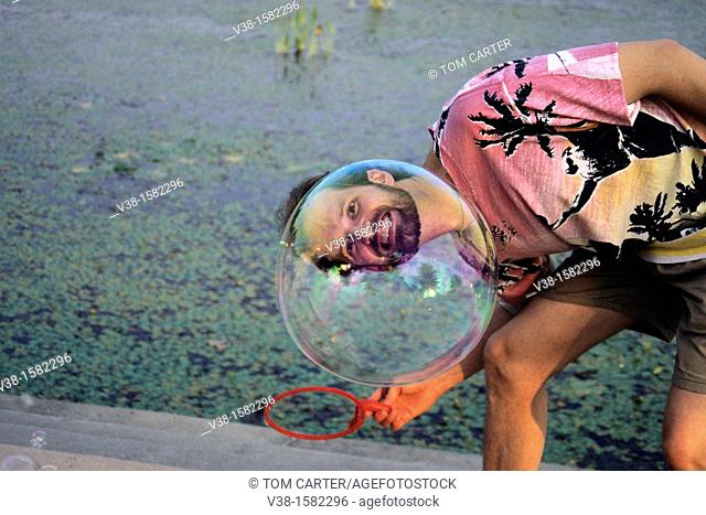 Man looks through a bubble