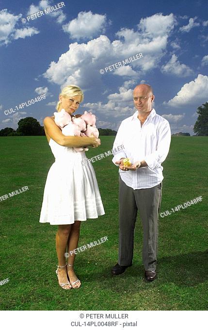 couple holding piggy banks