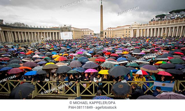 Tired believers wait at St. Peter's Square for smoke to rise from the chimney of the Sistine Chapel in the Vatican, 13 March 2013