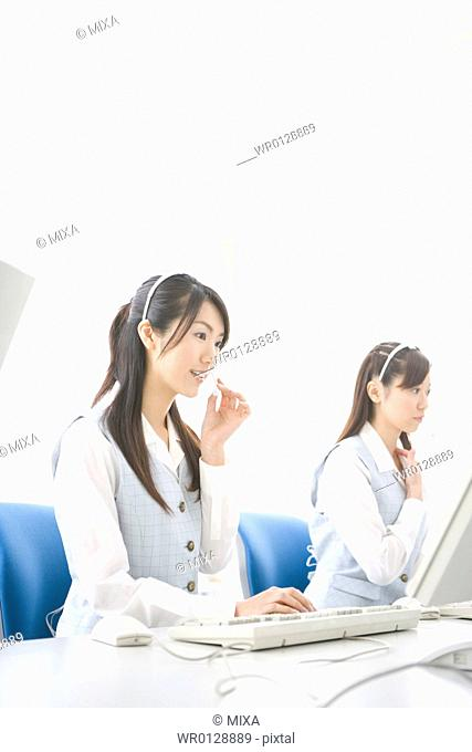 Two young women wearing headsets