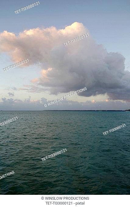 Cloudy sky above calm sea