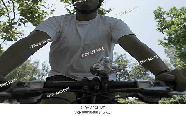 Time lapse of a man riding a bike through streets